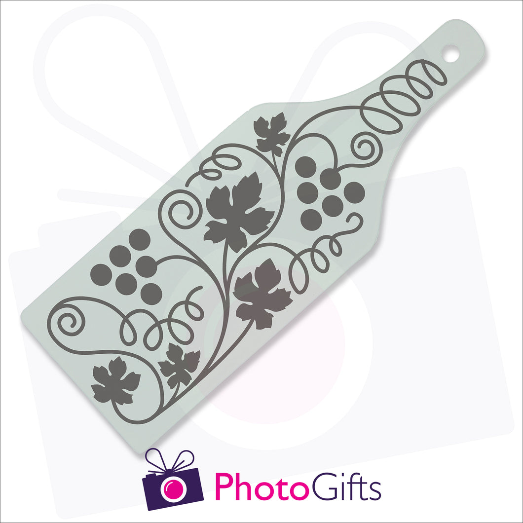 Bottle shaped glass chopping board personalised with your own choice of image as produced by Photogifts.co.uk