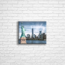 "Load image into Gallery viewer, Personalised 10x8"" Landscape wrapped canvas with your own choice of image hung on a white brick wall by Photogifts.co.uk"