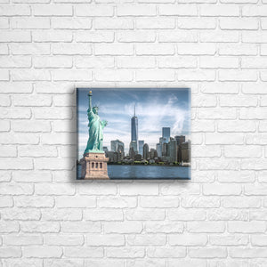 "Personalised 10x8"" Landscape wrapped canvas with your own choice of image hung on a white brick wall by Photogifts.co.uk"