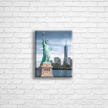"Load image into Gallery viewer, Personalised 10x8"" Portrait wrapped canvas with your own choice of image hung on a white brick wall by Photogifts.co.uk"