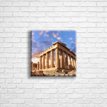 "Load image into Gallery viewer, Personalised 12x12"" square border canvas with your own choice of image hung on a white brick wall by Photogifts.co.uk"
