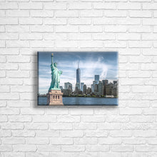 "Load image into Gallery viewer, Personalised 12x8"" Landscape wrapped canvas with your own choice of image hung on a white brick wall by Photogifts.co.uk"