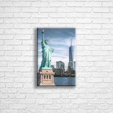 "Load image into Gallery viewer, Personalised 12x8"" portrait wrapped canvas with your own choice of image hung on a white brick wall by Photogifts.co.uk"