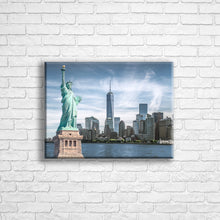 "Load image into Gallery viewer, Personalised 16x12"" Landscape wrapped canvas with your own choice of image hung on a white brick wall by Photogifts.co.uk"