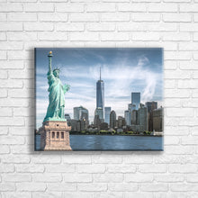 "Load image into Gallery viewer, Personalised 20x16"" landscape wrapped canvas with your own choice of image hung on a white brick wall by Photogifts.co.uk"