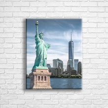 "Load image into Gallery viewer, Personalised 20x16"" portrait wrapped canvas with your own choice of image hung on a white brick wall by Photogifts.co.uk"