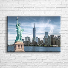 "Load image into Gallery viewer, Personalised 24x16"" landscape wrapped canvas with your own choice of image hung on a white brick wall by Photogifts.co.uk"