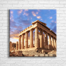 "Load image into Gallery viewer, Personalised 24x24"" square border canvas with your own choice of image hung on a white brick wall by Photogifts.co.uk"