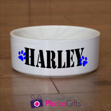 "Load image into Gallery viewer, White ceramic pet bowl with the name ""Harley"" and two paw prints printed on the sides of the bowl as supplied by Photogifts.co.uk"