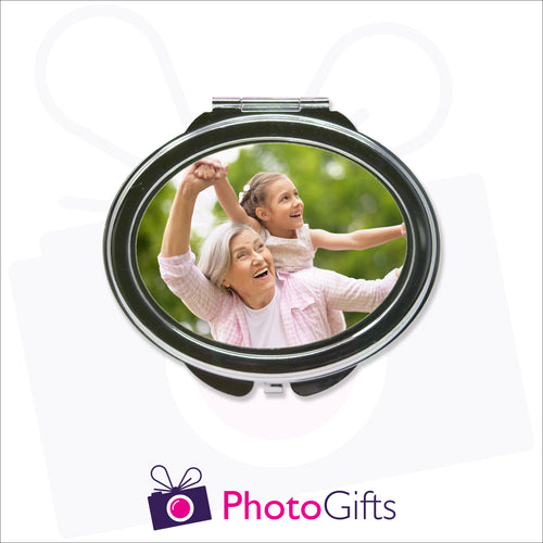 Personalised oval compact mirror with your own choice of image on the front as produced by Photogifts.co.uk