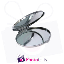 Load image into Gallery viewer, Partially opened personalised oval compact mirror with your own choice of image on the front as produced by Photogifts.co.uk
