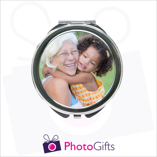Personalised round compact mirror with your own choice of image on the front as produced by Photogifts.co.uk