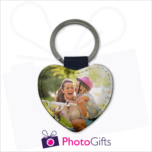 Double sided faux leather heart shaped keyring with your own choice of image on both sides as produced by Photogifts.co.uk