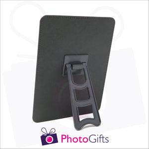 "Rear view of faux leather customised photo panel 182mm x 132mm (7"" x 5"") in portrait orientation. Picture details show plastic easel stand on back of the panel"