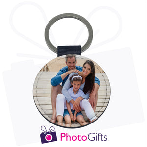 Round faux leather double sided keyring with your own choice of image on both sides as produced by Photogifts.co.uk