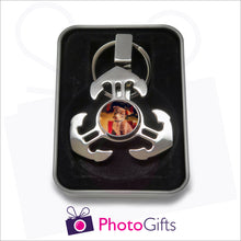 Load image into Gallery viewer, Anchor style fidget spinner on keyring in gift tin as supplied by Photogifts.co.uk. Your choice of image is printed on the middle part of the spinner.