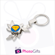 Load image into Gallery viewer, Personalised fidget spinner in flame shape on a keyring. Centre part of spinner is customised with your own choice of image as supplied by Photogifts.co.uk
