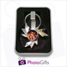 Load image into Gallery viewer, Flame shaped fidget spinner on keyring that is personalised with your own choice of image in presentation tin as supplied by Photogifts.co.uk