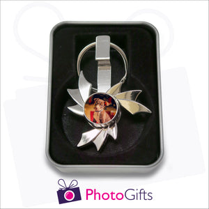 Flame shaped fidget spinner on keyring that is personalised with your own choice of image in presentation tin as supplied by Photogifts.co.uk