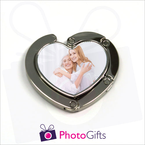 Heart shaped bag hanger in closed position with your own choice of image in the centre as produced by Photogifts.co.uk