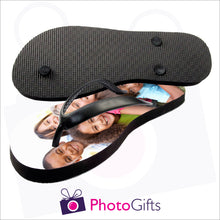 Load image into Gallery viewer, Image of top and bottom of Large kids sized personalised flip-flops with your own choice of image as produced by Photogifts.co.uk