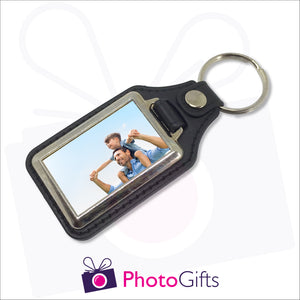 Traditional leather keyfob style with your own choice of image printed on one side. Image is rectangular in shape and in a small metal frame.