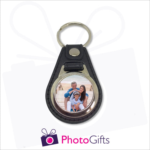 Traditional leather keyfob style with your own choice of image printed on one side. Image is round in shape and in a small metal frame.