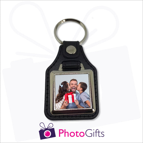 Traditional leather keyfob style with your own choice of image printed on one side. Image is square in shape and in a small metal frame.