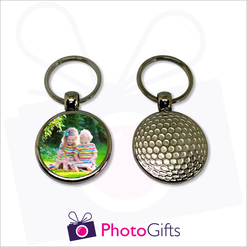Personalised metal keyring with one side resembling a golf ball and the other with your own choice of image as supplied by Photogifts.co.uk