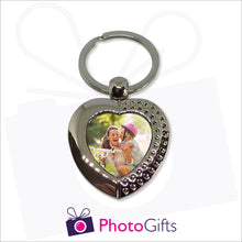 Load image into Gallery viewer, Metal pendant keyring in the shape of a heart with small rhinestones on edge of heart. Your own choice of image is in the centre as produced by Photogifts.co.uk
