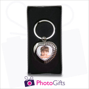Personalised heart shaped metal pendant keyring with rhinestone detailing and your own choice of image in the centre. Keyring is displayed in a box as produced by Photogifts.co.uk