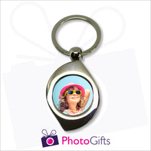 Load image into Gallery viewer, Metal leaf shaped pendant keyring with your own choice of image in the centre as produced by Photogifts.co.uk