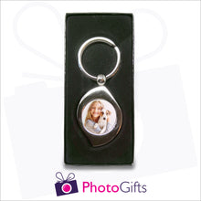 Load image into Gallery viewer, Personalised metal leaf shaped keyring in presentation box with your own choice of image in the centre as produced by Photogifts.co.uk