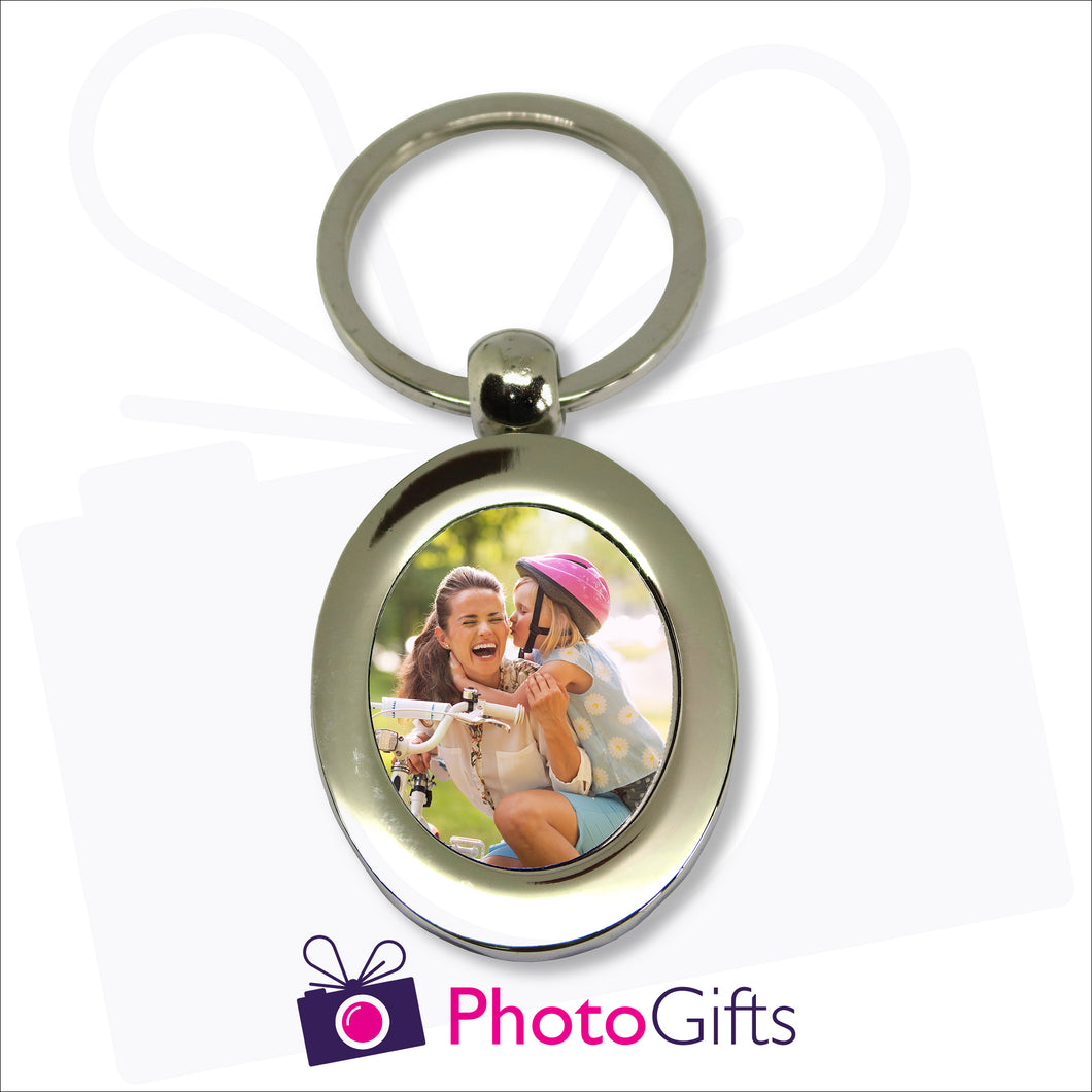 Metal pendant keyring in the shape of an oval with your own image in the centre of the keyring as produced by Photogifts.co.uk
