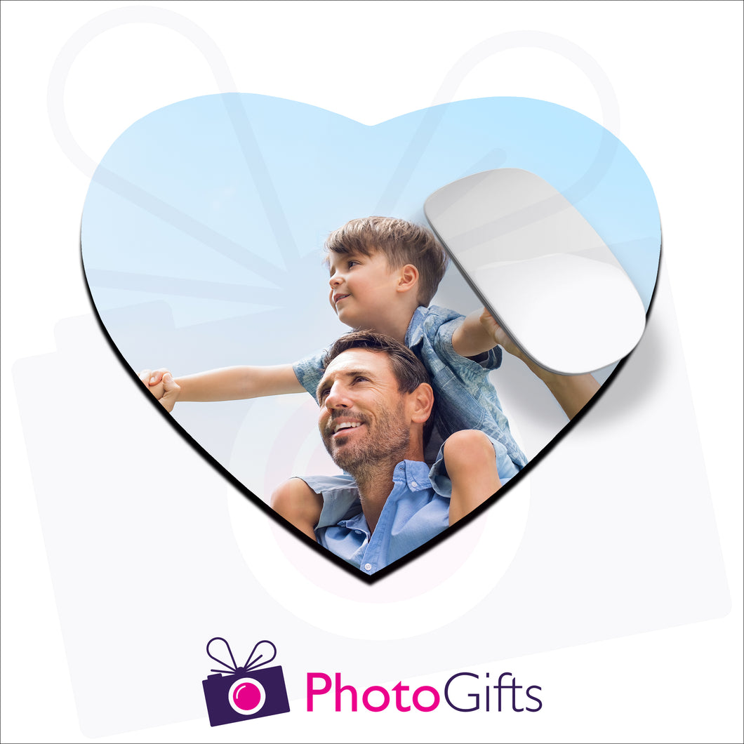 Heart shaped mousemat that is personalised with your own choice of image as produced by Photogifts.co.uk