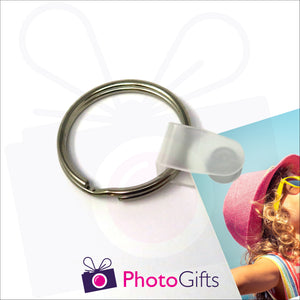 Close up of clasp and ring from personalised plastic keyring as produced by Photogifts.co.uk