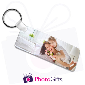 Double sided plastic keyring in a rectangular shape with your own choice of image on both sides as produced by Photogifts.co.uk