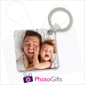 Double sided square durable plastic keyring with your own choice of image printed on both sides as produced by Photogifts.co.uk