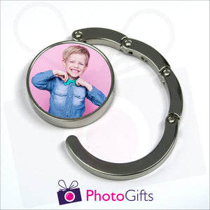 Round bag hanger with your own choice of image in the centre is partially open as produced by Photogifts.co.uk