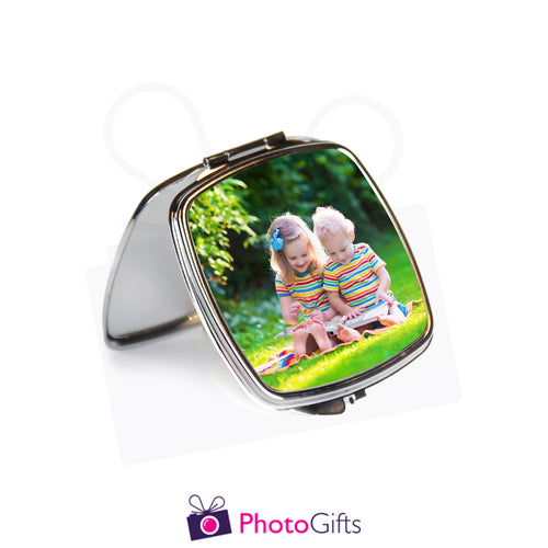 Open view of personalised square compact mirror with your own choice of image on the front as produced by Photogifts.co.uk