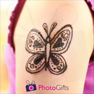Temporary tattoo as shown on an arm as produced by Photogifts.co.uk