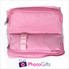 Load image into Gallery viewer, Inside detail of pink personalised vanity case showing two zipped pockets and mini pocket as produced by Photogifts.co.uk