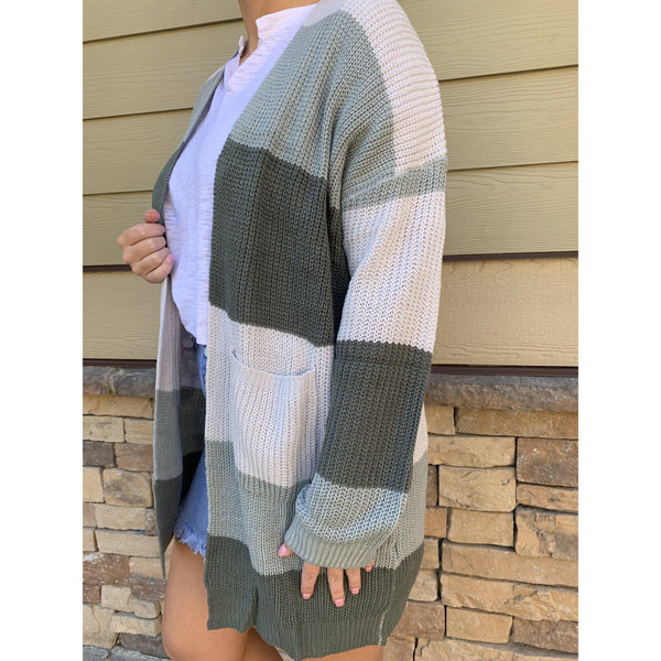 Our Striped Simply Southern Cardigans are lightweight, true to size, and adorable. Longer length and will travel easy.