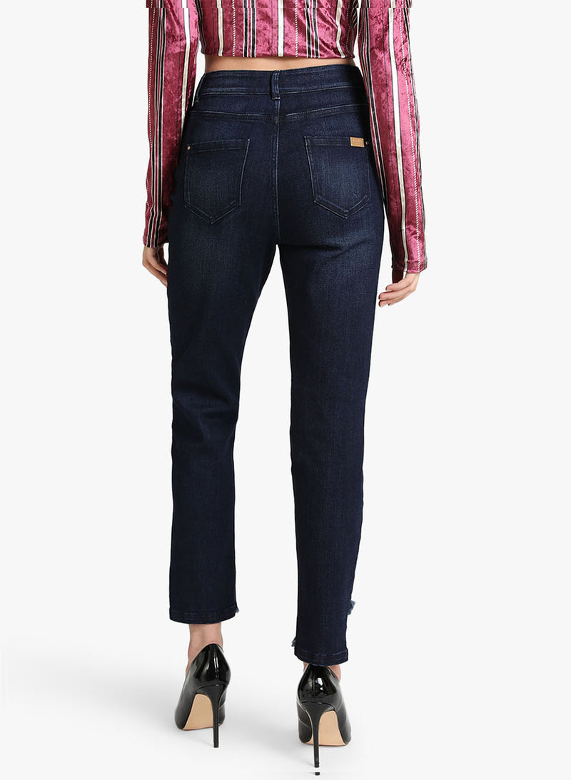 Jeans With Cross Fringes At The Hem