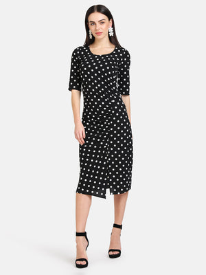 POLKA DOT MIDI DRESS WITH FRONT RUCHING DETAIL.