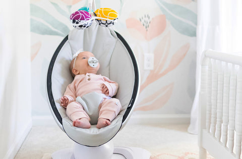 Baby in an electric baby swing