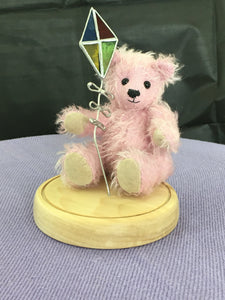 Pink Mohair Collectors Bear Flying a Stained Glass Kite on a Maple Plinth