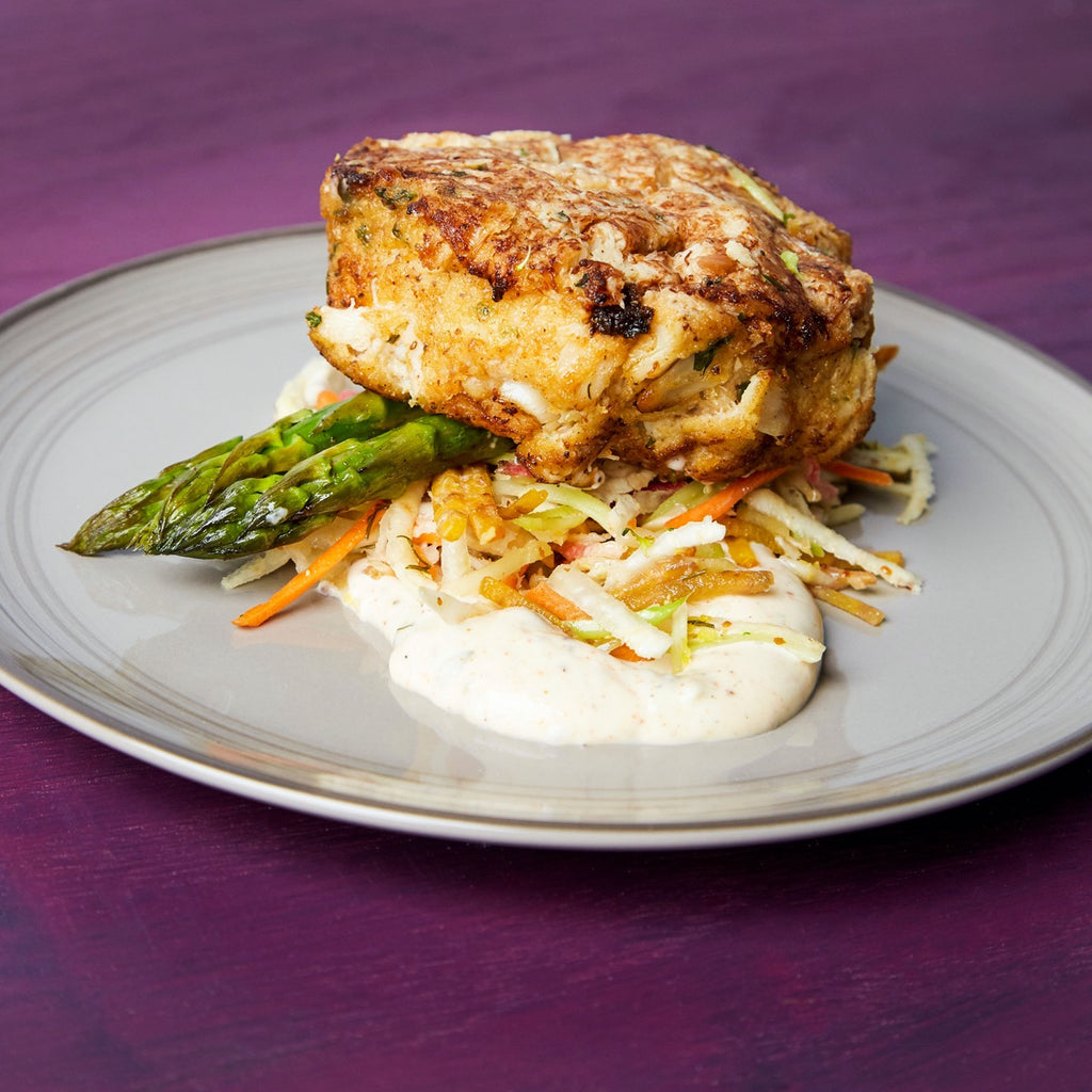 Pan-seared Jumbo lump Maryland Crab Cake with Celery Root Slaw and Asparagus