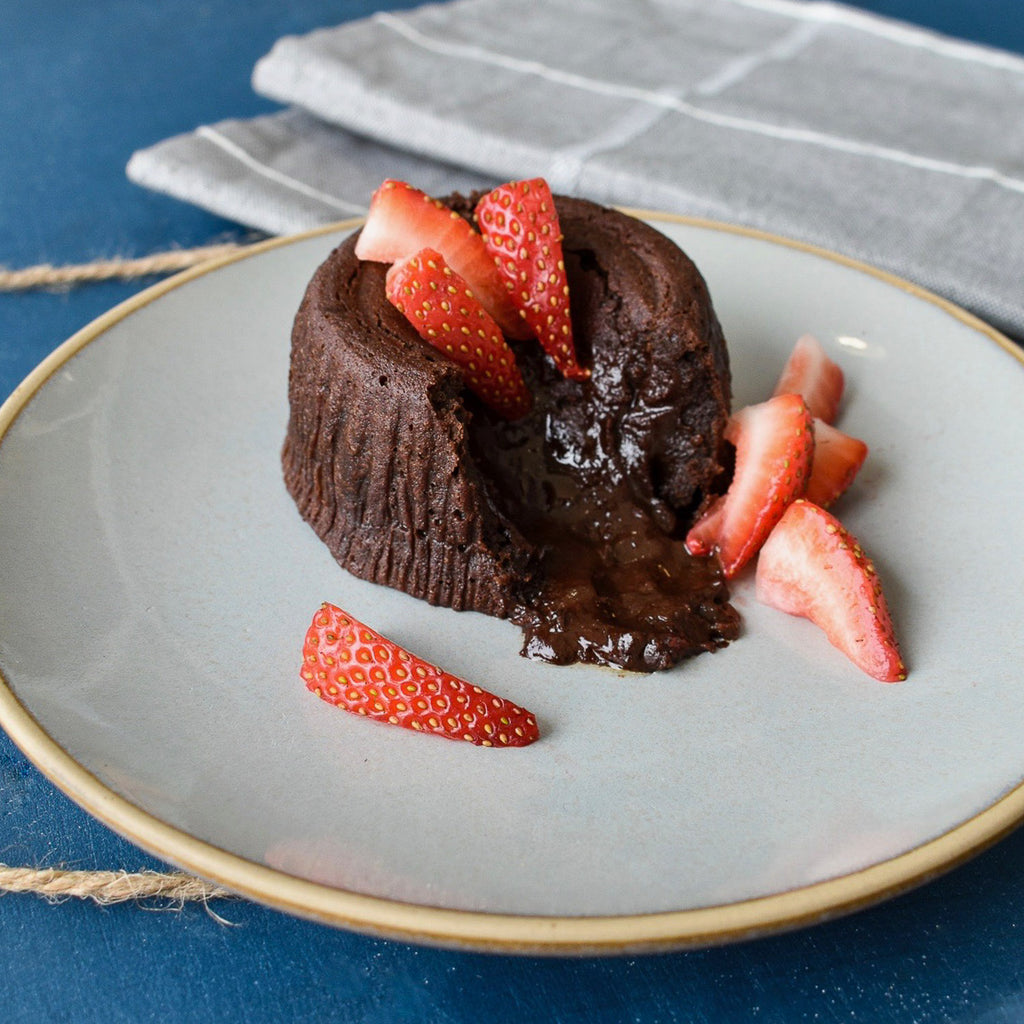 Dark Chocolate Truffle Cake served warm with fresh strawberries