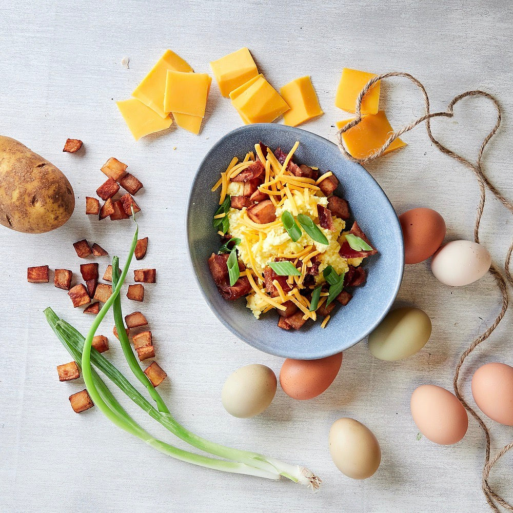 Bacon Cheddar Egg Bowl, a hearty breakfast option ready in minutes. (Serves 1)